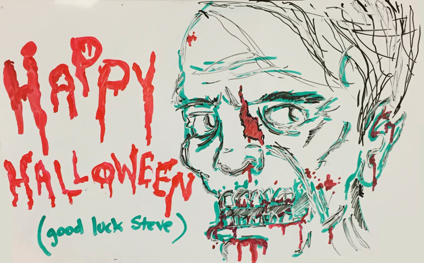 Whiteboard art by Tony Todoroff, with a zombie wishing me a Happy Halloween and good luck