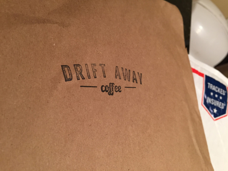 The handsome, brown paper packaging with the Driftaway Coffee logo stamped on the front