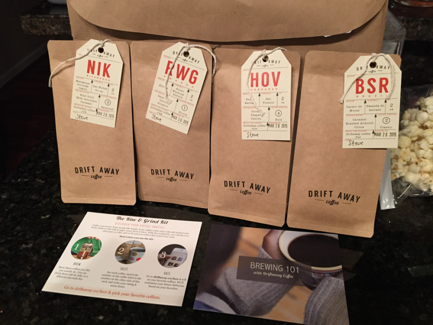 Contents of the Driftaway Coffee sampler: four 2oz bags of coffee and a brewing 101 guide